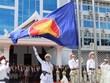 Лаос проводит церемонию поднятия флага, чтобы отметить 53-ю годовщину АСЕАН