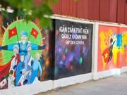Дорога пропагандистских плакатов против COVID-19 в Ханое