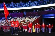 Спортивная делегация Вьетнама на церемонии открытия Олимпийских игр в Токио (фото)