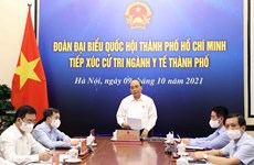 Президент Нгуен Суан Фук провел встречу с избирателями в секторе здравоохранения в Хошимине