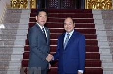 Премьер-министр: Вьетнам полон решимости продолжать улучшать инвестиционную среду