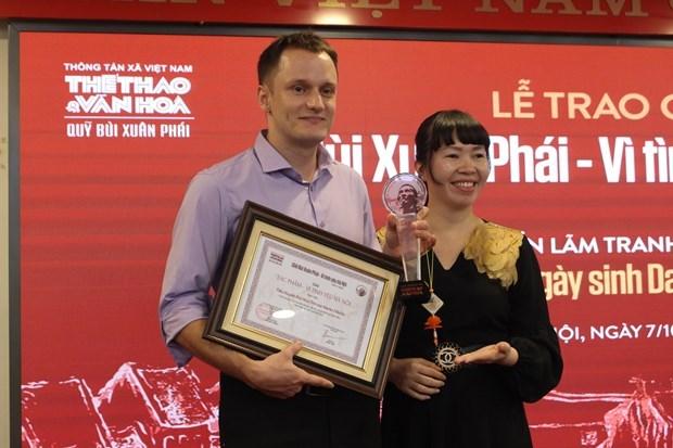 """Музыкант Фу Куанг получил премию им. Буи Суан Фая """"За любовь к Ханою"""" hinh anh 3"""