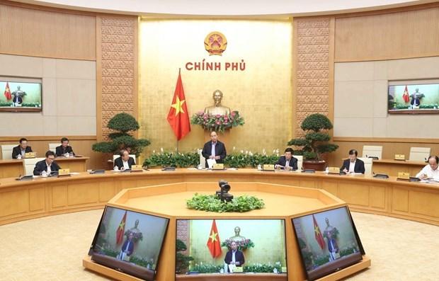 """Премьер-министр: Вьетнам находится на """"золотом этапе"""" в профилактике и борьбе с COVID-19 hinh anh 1"""