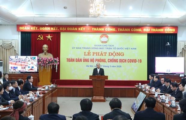 Премьер-министр: солидарныи вклад всего населения необходим для борьбы с COVID-19 hinh anh 1