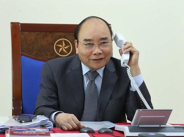 Премьер-министр провел телефонные переговоры с лаосскими камбоджиискими коллегами hinh anh 1