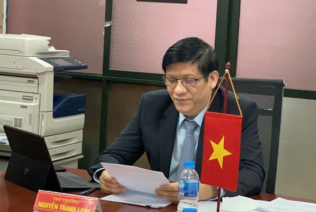 Представители здравоохранения Вьетнама и Лаоса обсуждают способы борьбы с COVID-19 hinh anh 1