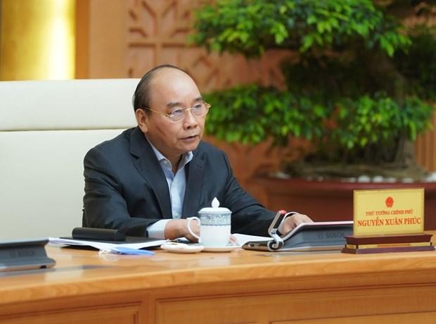 Всевьетнамская видеоконференция по обсуждению решении проблем, связанных с COVID-19 hinh anh 1