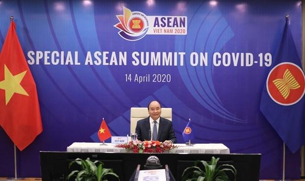Премьер-министр Вьетнам выступил со вступительнои речью на Специальном саммите АСЕАН по борьбе с COVID-19 hinh anh 1