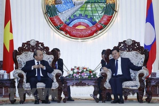 Премьер-министр Нгуен Суан Фук принял участие в государственных похоронах бывшего премьер-министра Лаоса hinh anh 3