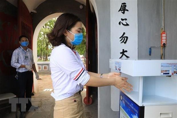 YouGov: Вьетнам больше всего доверяет СМИ в освещении ситуации с COVID-19 hinh anh 1