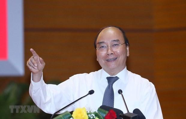 Премьер-министр похвалил СМИ за их вклад в борьбу COVID-19 hinh anh 1