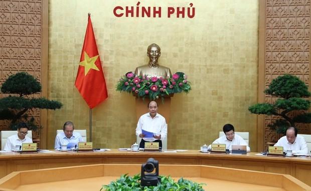 Премьер-министр: Высокии уровень защиты от COVID-19 должен оставаться для обеспечения здоровья общества hinh anh 1