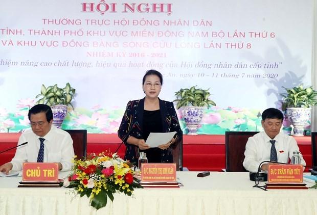 Председатель НС приняла участие в конференции народных советов южных местностеи hinh anh 1