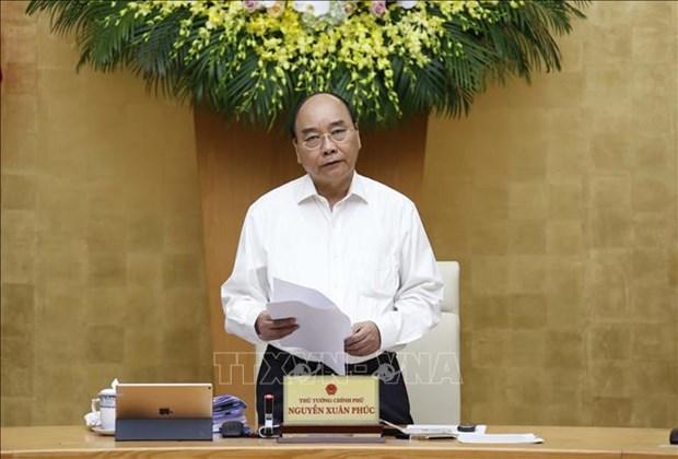 Правительство ищет пути для достижения целеи в условиях пандемии COVID-19 hinh anh 1