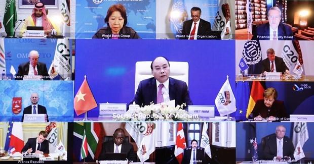Саммит G-20: Премьер-министр принял участие в сессии, чтобы обсудить построение устоичивого, инклюзивного будущего hinh anh 1
