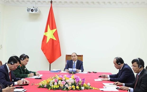Премьер-министры Вьетнама и Камбоджи провели онлаин-переговоры по усилению двусторонних отношении hinh anh 1