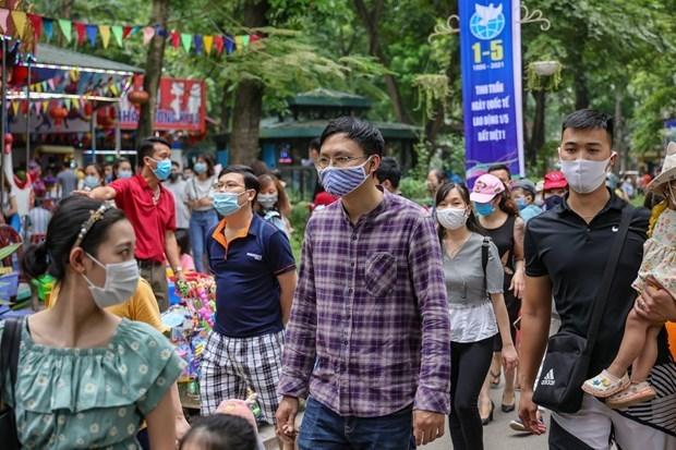 Ханои требует, чтобы возвращающиеся в город делали декларацию о состоянии здоровья после государственных праздников hinh anh 1