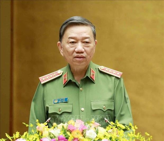 Генерал милиции То Лам высоко оценил вклад милиции в предотвращение эпидемии COVID-19 и борьбу с неи hinh anh 1