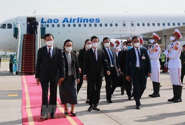 Лаосская пресса приветствует визит главы Лаоса во Вьетнам hinh anh 1