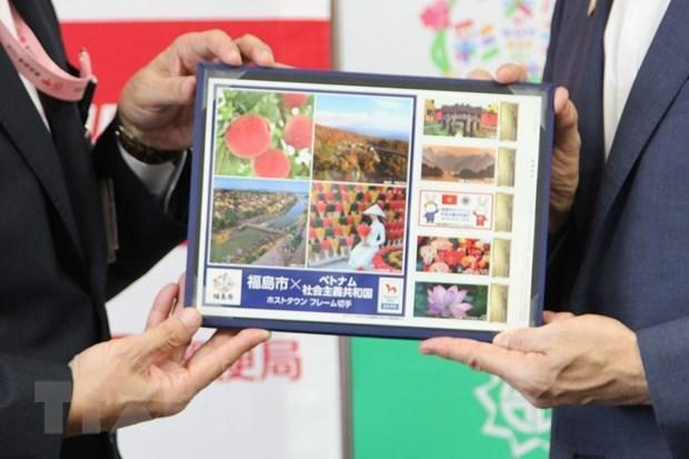 Фукусима выпустила наборы марок как город, принимающии олимпиискую делегацию Вьетнама hinh anh 1