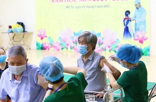 По всеи стране было введено более 30,4 миллиона доз вакцины против COVID-19 hinh anh 1