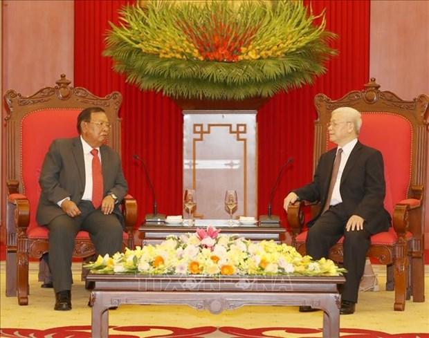 Генеральныи секретарь ЦК КПВ, Президент Вьетнама принял Генерального секретаря НРПЛ, Президента Лаоса  hinh anh 1