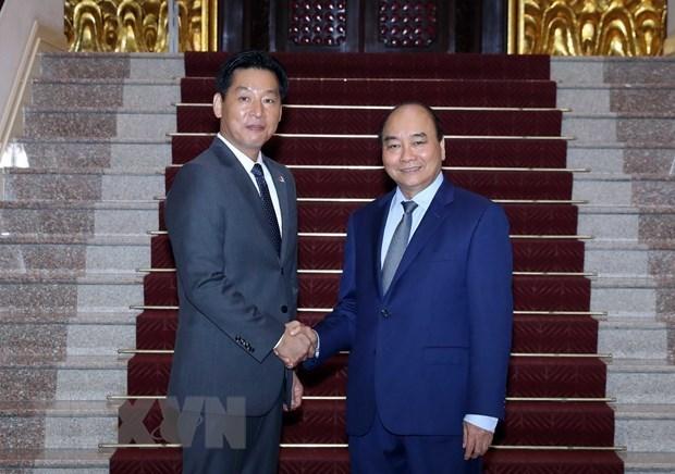 Премьер-министр: Вьетнам полон решимости продолжать улучшать инвестиционную среду hinh anh 1